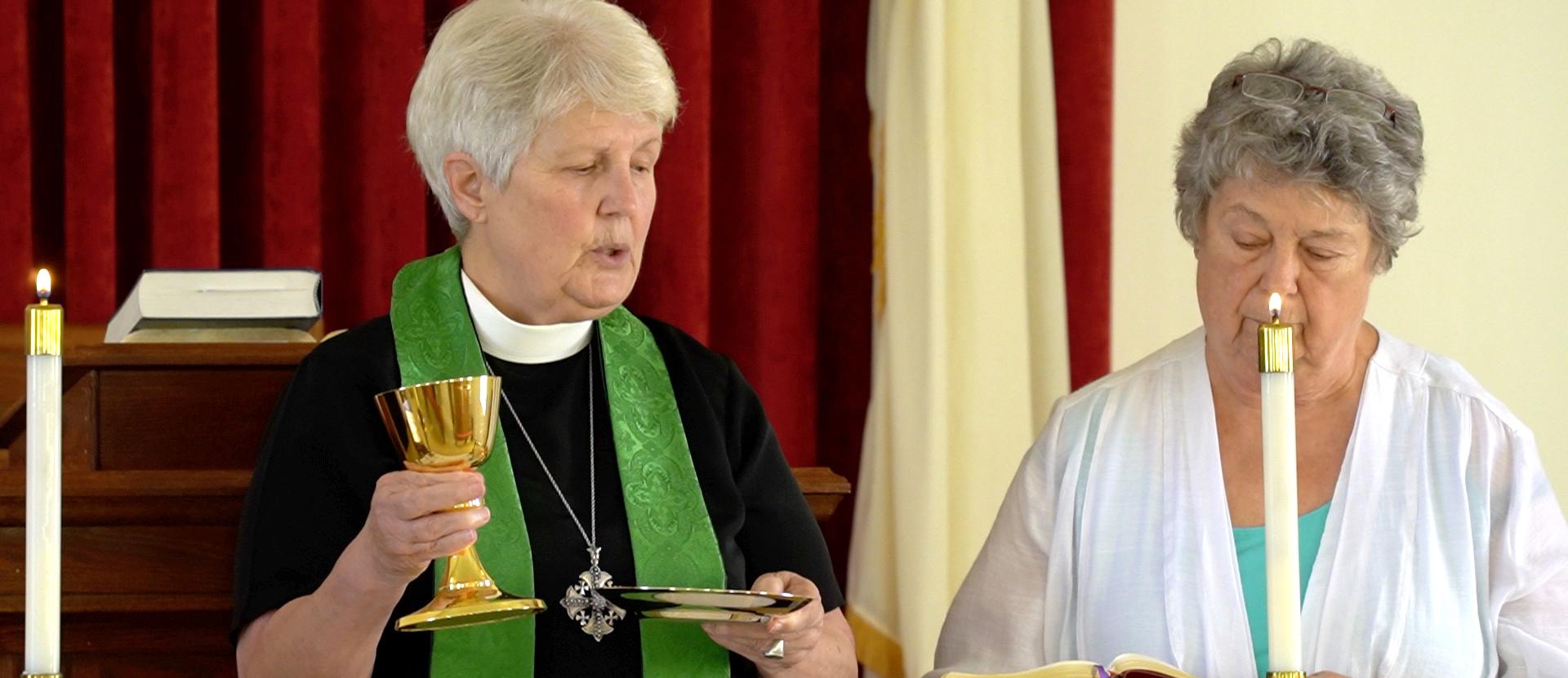 Vicar invites congregation to the eucharist